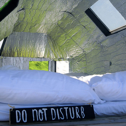 Ronnie Kommene detailed shot of the inside of the Bedbug with a sign do not disturb